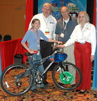 Photo of Lyndsey Jelenik being Awarded a New Bike