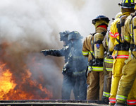 Photo of Men Fighting a Fire