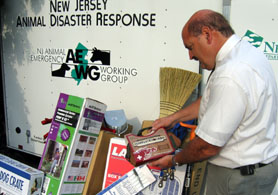 Photo of Ken Mandoli looking at trailer items - Click to enlarge