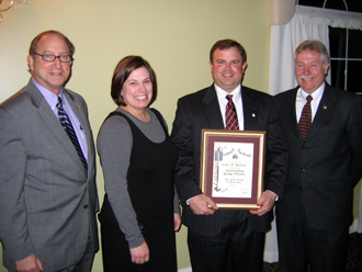 Photo of Secretary Fisher, Stacy Melick, John Melick and Scott Ellis