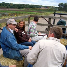 Photo of Secretary Fisher on a hayride at Abma's farm