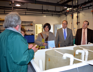 Photo of officials touring the Aquaculture Innovation Center