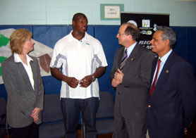 Photo of School Superintendent Fran Wood, Ferguson, Secretary Fisher and Assemblyman Upendra Chivukula - Click to enlarge