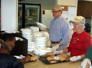 Photo of Secretary Fisher at Soup Kitchen