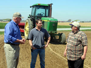 Photo of Secretary Kuperus with Michael Brooks and his father Bill at their farm in Elmer