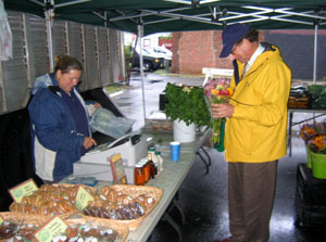 Photo Secretary Fisher at Stony Hill Farm's booth at the Caldwell Farmers Market