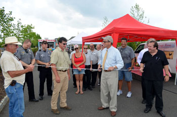 Photo of Secretary Fisher cutting the ribbon for a new season at the Chesterfield Farmers Market