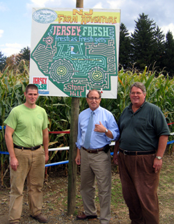 Photo of Dale Davis IV, Secretary Fisher and Dale Davis at entrance to Jersey Fresh maze