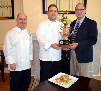 Photo of Sous Chef Al Hughes, Chef Demetrios Haronis and Secretary Fisher with the NJTop Seafood Chef Award