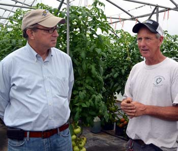 Photo of Secretary Fisher and John Dooley in his greenhouse