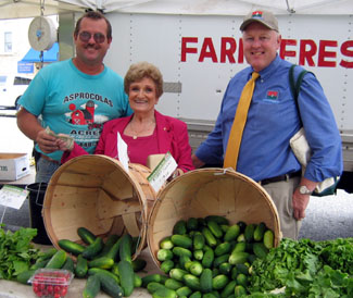 Photo of farmer George Asprocolas, Mayor Rose Heck and Secretary Kuperus at the Hasbrouck Heights farmers market