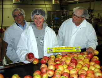 Photo of Fred and Cheryl-Ann Sorbello and Secretary Fisher at the cider mill