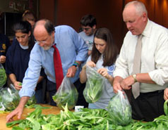 Photo of Governor Corzine and Secretary Kuperus Helping Anti-hunger Effort - Click to enlarge