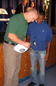 Photo of the Jets Matthew Mulligan signing an autograph during the program