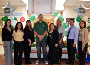 Photo of Oak Street School officials with Jets player Josh Baker