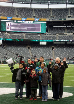 Roosevelt School group on the field at the Jets game