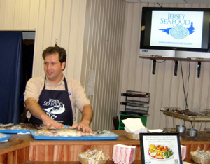 Photo of Joe Myers doing a fish demo