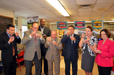Photo of officials tasting Jersey Fresh berry yogurt parfaits.