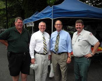 Photo of Kurt Alstede, Al Murray, Secretary Fisher and Dale Davis