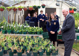 Photo of Secretary Kuperus in the Allentown HS greenhouse with FFA members - Click to enlarge