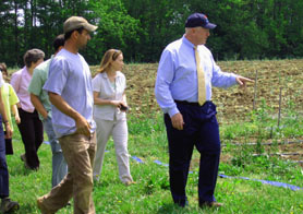 Photo of Matt Conver showing Secretary Kuperus his organic farm - Click to enlarge