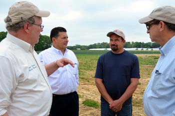 Photo of Peter Furey, Secretary Fisher, Andrew Pagnini and Freeholder Fiocchi in Pagnini's herb field.