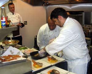 Photo of chefs preparing black sea bass dish