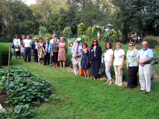 Photo of group of federal, state and school officials at the Riverside School garden
