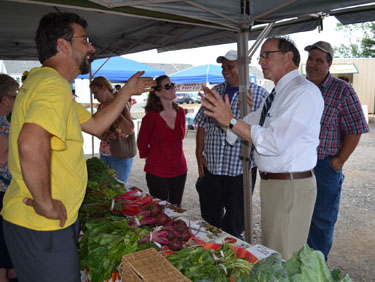 Secretary Fisher visits a farmer at the Robbinsville Farmers Market