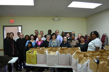 Photo of Secretary Fisher with St. Andrew-Resurrection Food Pantry volunteers