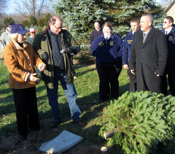 Photo of Lt. Governor Guadagno and Secretary Fisher chopping down a tree
