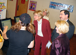 Photo of officials looking at how computerized lunch payment system works