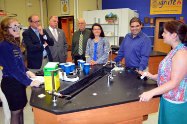 Photo of Woodstown HS Agricultural Education student demonstrating a soil test for dignitaries