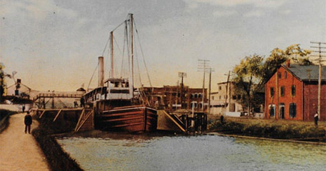 Colorized black and white photo of a boat in the canal