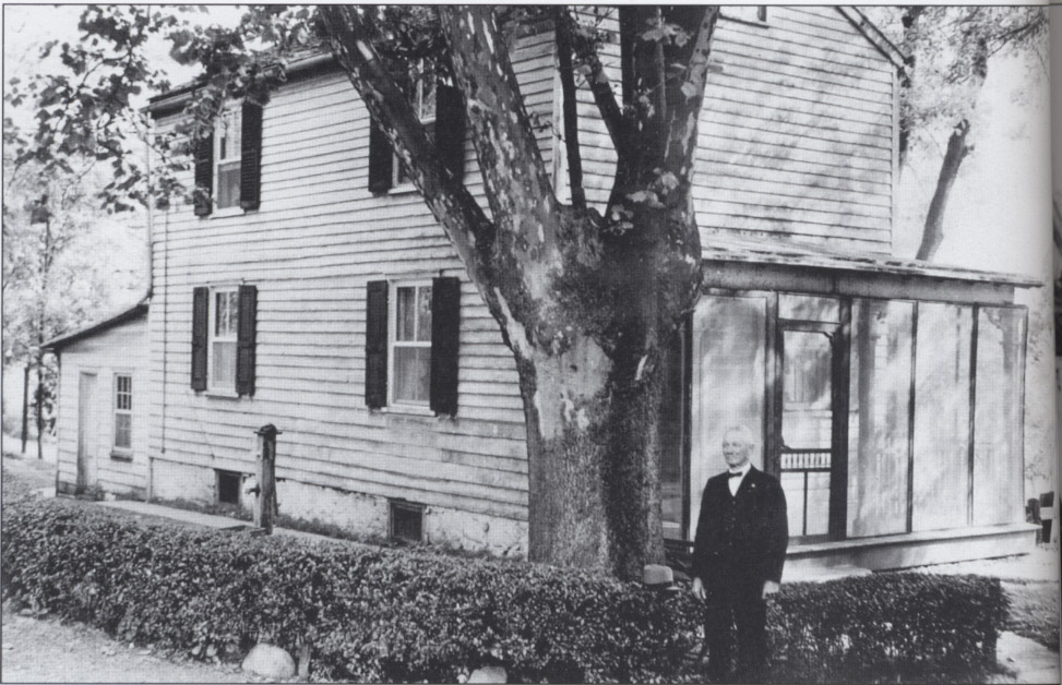 This photograph shows bridgetender John Arrowsmith standing in front of his home in the Port Mercer section of Lawrence Township.  Mr. Arrowsmith tended the Port Mercer swing bridge from 1900 until the canal's closure in 1932.  Today, the home serves as the headquarters of the Lawrence Historical Society.