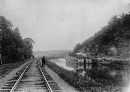 Two hinge (or section) boats wait to be loaded at the Goat Hill stone quarry south of Lambertville around the year 1900.  Several quarries along the Delaware River produced brownstone for buildings in Trenton, Philadelphia and New York City.  Streets in those cities were also paved with cobblestones taken from the bed of the Delaware River and transported through the Delaware and Raritan Canal through the Lambertville outlet lock.