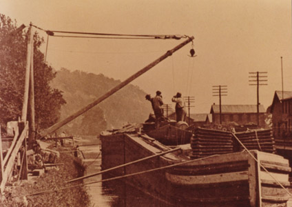 This photograph shows a canal boat unloading jute at the Lambertville Paper Mill.  The mill produced a variety of products, including paper insulation used for electrical wiring.  (Photograph courtesy of William McKelvey, Jr.)