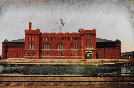 The Delaware and Raritan Canal is seen flowing in the foreground of the 2nd Regiment Armory building, located near present-day East State and Stockton Streets in Trenton.  The building, which was one of five State armories designed by the New Jersey architect Charles Alling Gifford (1860-1937), housed the city's tax, welfare and housing records.  The armory was destroyed by fire on July 16, 1975, and the site is presently occupied in part by the Trenton City Hall Annex.