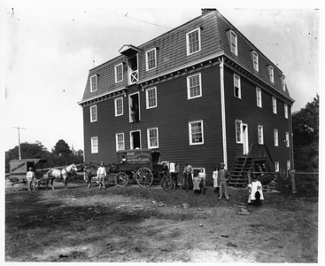 This 1900 photograph shows the Kingston Flour Mill, which produced the Golden Wing and Seal brands of flour.  The present mill structure was built in 1888 and was in operation through the 1940s under the ownership of Matthew Suydam, Jr.  Today the mill is a private residence and a picturesque reminder of the historic and economic development of the community.  In 1986, the Kingston Mill Historic District was added to the State and Federal Registers of Historic Places.