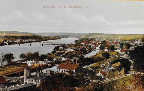 This bird's eye view of Lambertville taken after 1904 illustrates the importance of the Feeder Canal to the city, as well as its relationship to the Delaware River.  Water power was supplied from the canal to the many mills and factories clustered along the waterway.  The basin below the Lambertville Lock provided the necessary clearance for canalboats to rotate 90 degrees in order to enter and exit the outlet lock to the Delaware River.