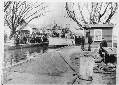 The Ex-Spanish Navy gunboat Alvarado draws a curious crowd in New Brunswick as it makes its way through the Delaware and Raritan Canal in 1899 on its way to the U.S. Navy base at Portsmouth, N.H.  The Alvarado was captured during the fall of Santiago de Cuba during the Spanish-American War.  She was ultimately used as a training ship at the United States Naval Academy before being struck from the Naval Register in 1912.