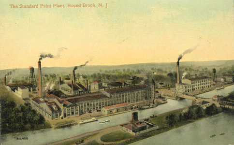 "Erroneously labeled as ""Bound Brook,"" this image depicts the Standard Paint Company plant in South Bound Brook Borough, Somerset County.  Note the A-frame swing bridge in the lower right corner of the image, and the truss bridge over the Raritan River."