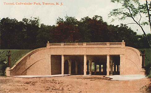 This colorized postcard shows the aqueduct that conveys the Delaware and Raritan Canal over Parkside Avenue in the City of Trenton