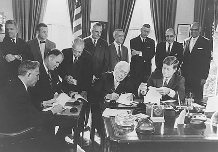 Photo of ceremonial signing of the compact at the White House.