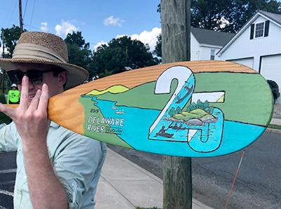 This year's paddle incorporates the Sojourn's Tshirt design by Dejay Branch and was created by Sandy Schultz. Photo by Michelle Mormul.