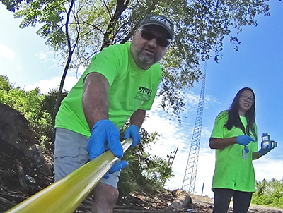 DRBC Mgr. of Water Quality Assessment John Yagecic and Water Quality Intern Daisy DePaz collect a surface water sample to monitor for bacteria levels. Photo by DRBC.
