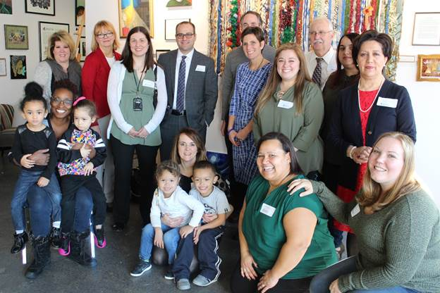 Commissioner Kimberley Harrington and New Jersey Department of Education staff with children and families at HomeFront Family Campus in Ewing.
