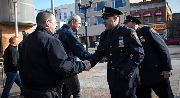 Photo: Phil Murphy shaking hands with officers