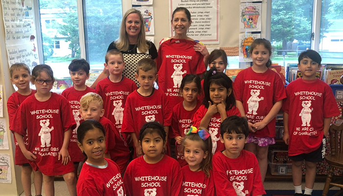 First Lady and group of children from Whitehouse School  dressed read TShirt