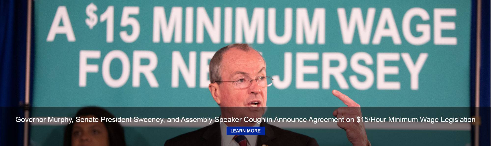 Governor Phil Murphy, Banner - $15 Minimum Wage